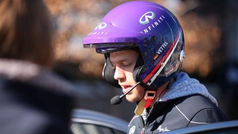 Sebastian Vettel takes time off from F1 winning to drive an Infiniti Q50 on hotlaps in Infiniti HQ parking lot