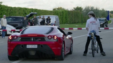 Watch a Guy on a Bicycle Make a Ferrari Cry on the Race Track