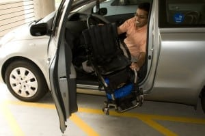16393-a-disabled-man-in-a-wheelchair-getting-out-of-a-car-pv